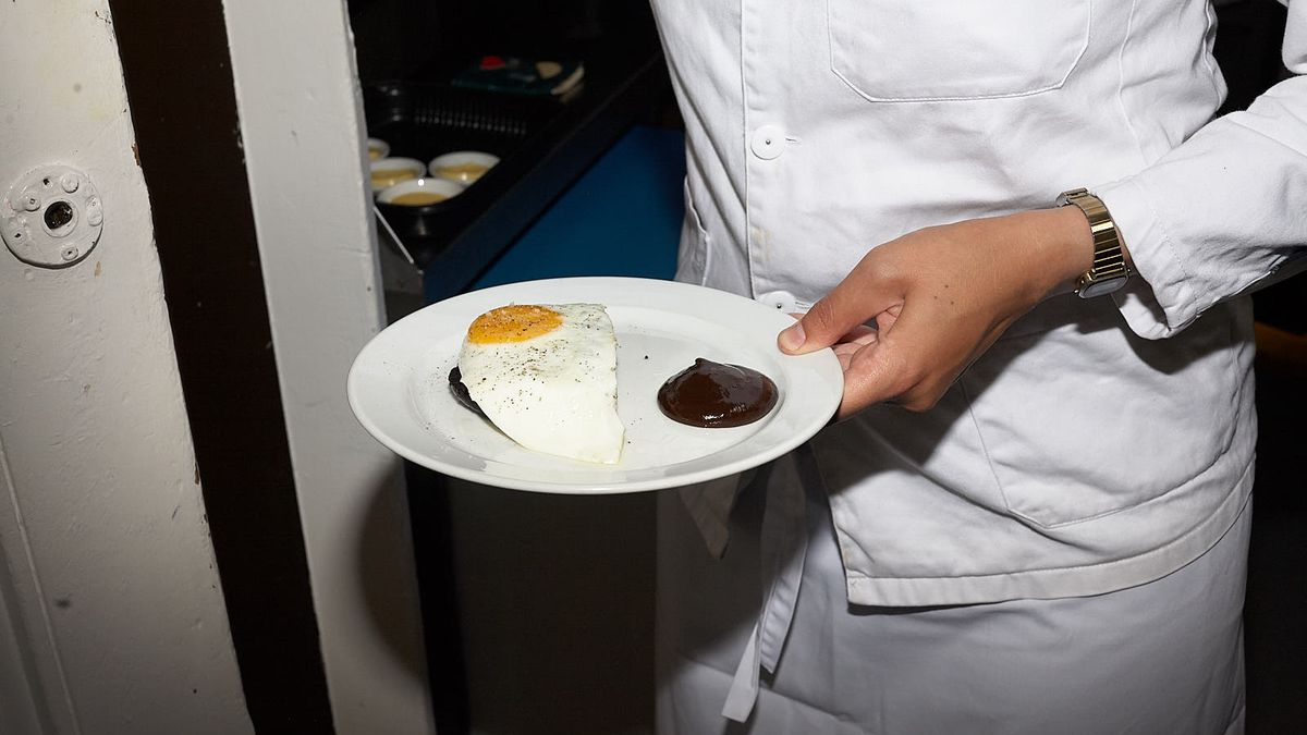 A plate being carried from the kitchen of St. John Bread and Wine in Spitalfields last autumn