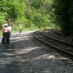 This July 14, 2012 photo shows bicyclists embarking on the long descent into Cumberland, Md., in the final leg of a three-day ride on the Great Allegheny Passage. The trail between Pittsburgh and the Western Maryland town of Cumberland is a smooth-rolling romp through the mountains in spring, summer and fall.