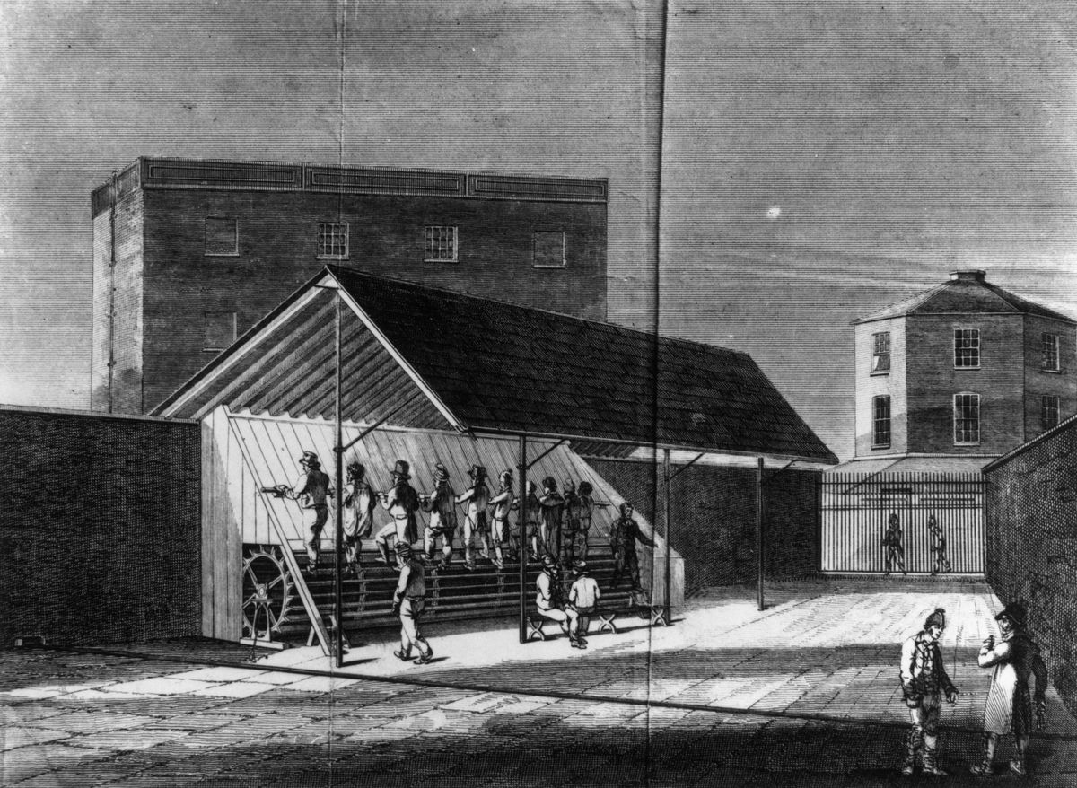 A row of men march side by side on a torture device from the 1850's. Archival image.