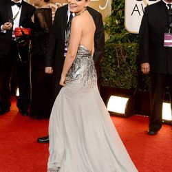 Mila Kunis backing it up in silver Gucci.