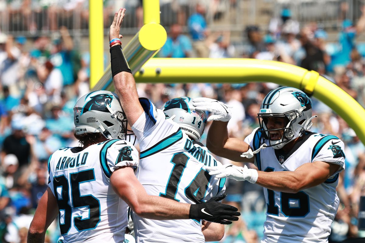 Sam Darnold #14 of the Carolina Panthers celebrates after a five-yard rushing touchdown against the New York Jets during the second quarter at Bank of America Stadium on September 12, 2021 in Charlotte, North Carolina.