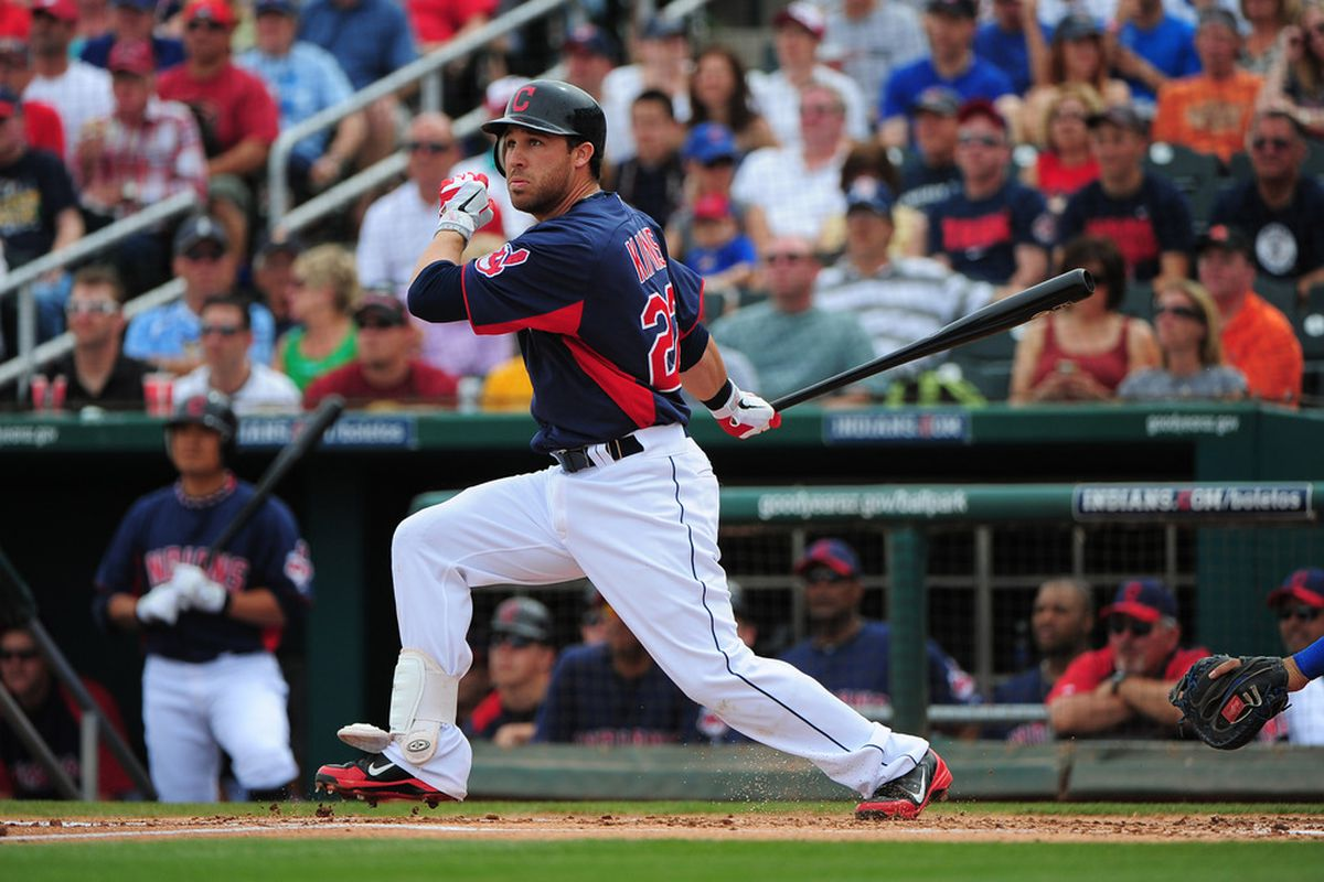 March 25, 2012; Goodyear, AZ, USA; Cleveland Indians second baseman Jason Kipnis (22) hits a double during the first inning against the Chicago Cubs at Goodyear Ballpark. Mandatory Credit: Kyle Terada-US PRESSWIRE