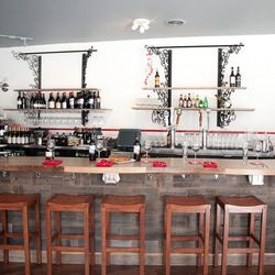 The bar is made from repurposed French wine barrels.