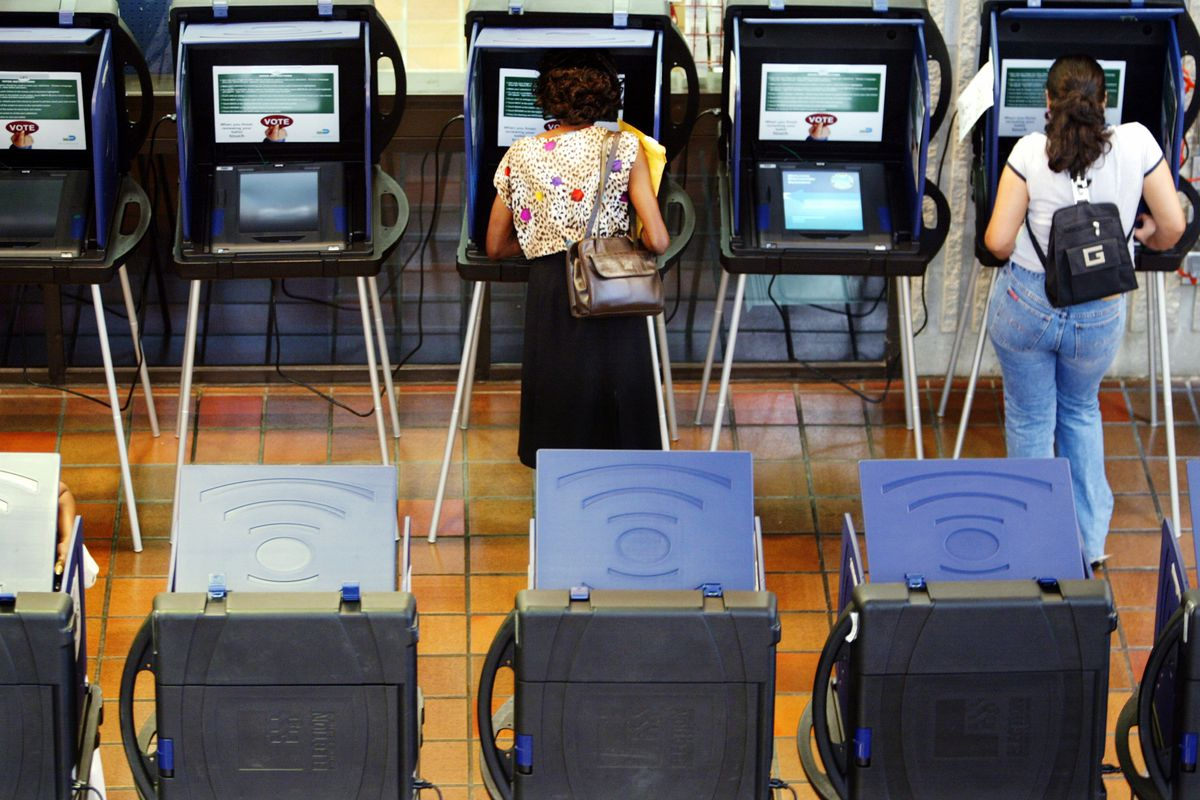 MIAMI - OCTOBER 22:  Voters cast their ballots on the new touch-screen machines at one of 14 polling places open to registered Miami-Dade voters before the November 5, 2002 election October 22, 2002 at County Hall in Miami, Florida.