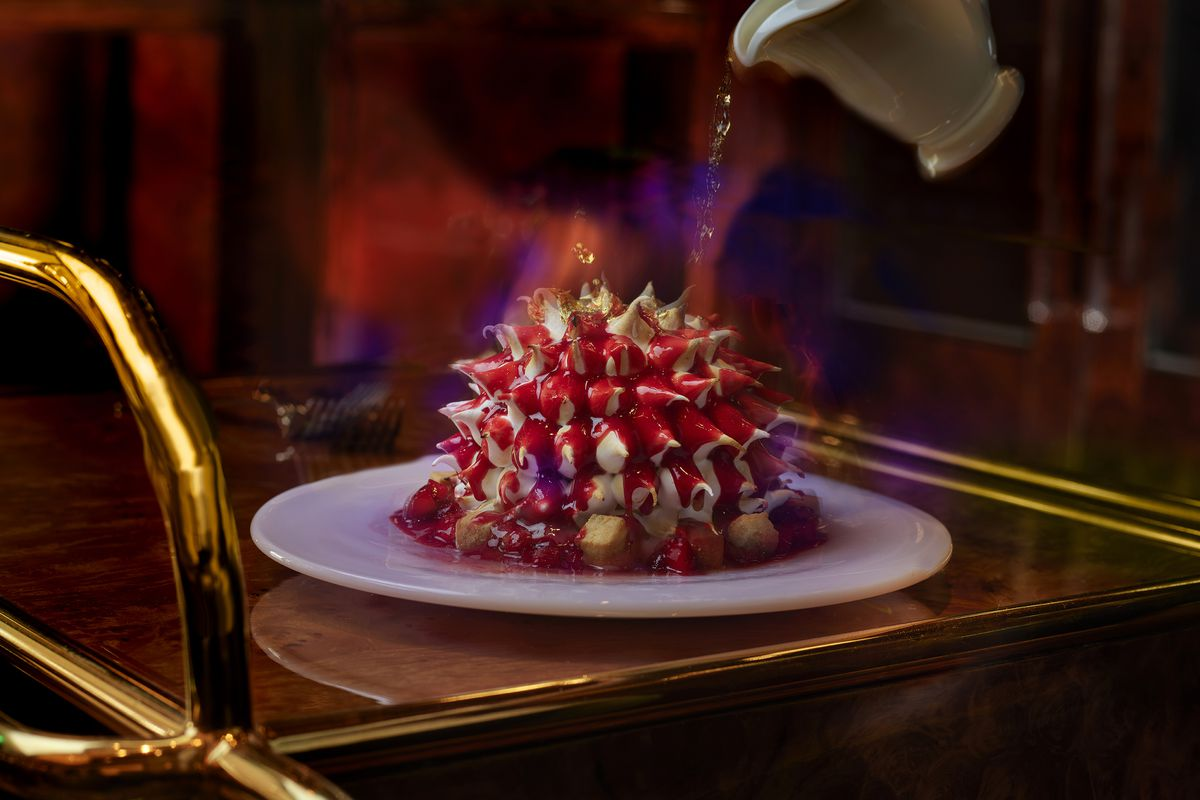 A red dessert with spikes on a cart