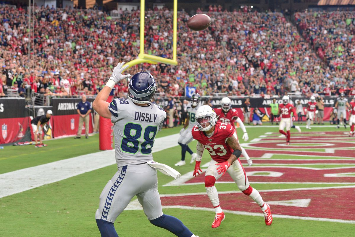 Seattle Seahawks tight end Will Dissly catches a touchdown pass as Arizona Cardinals cornerback Byron Murphy defends during the first half at State Farm Stadium.