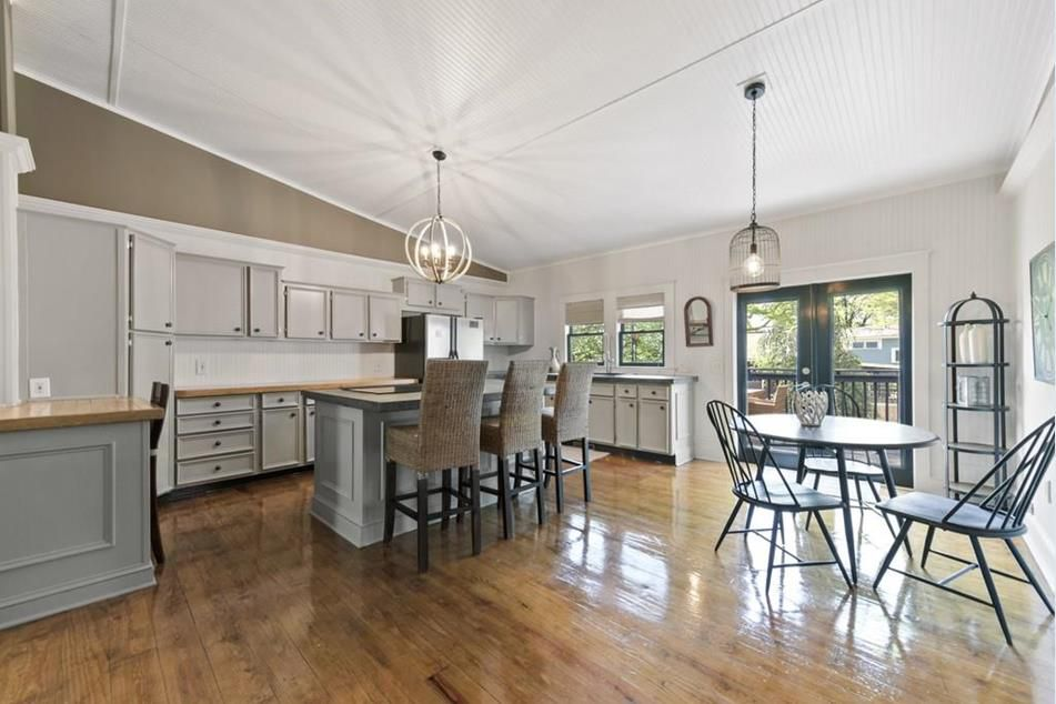 A large brown and white kitchen space.