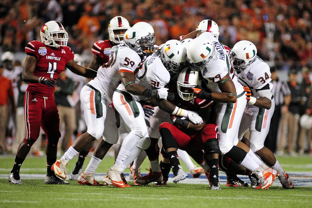 The Miami Defensive Line crushes Louisville in the backfield.