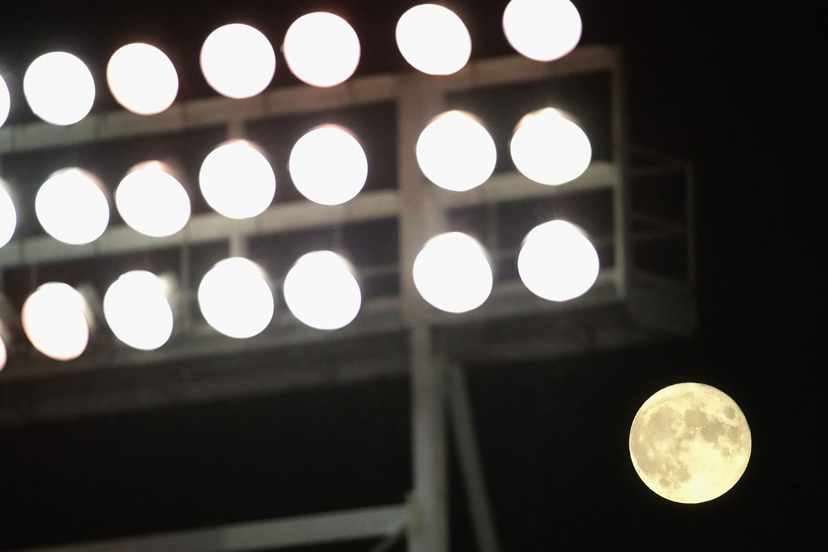 A full moon rises over Wrigley Field as the Chicago Cubs take on the Kansas City Royals on August 03, 2020 in Chicago, Illinois.
