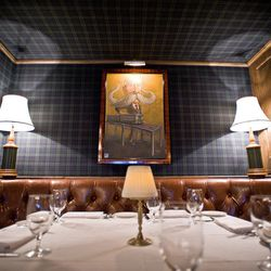 An old-timey caricature adds whimsy to the private booth