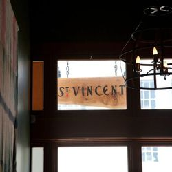 This sign is made from a table from the space's former inhabitant, Heart Wine Bar.