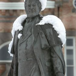 Snow piles high on the head and shoulders of the statue of Brigham Young in front of the Provo Library at Academy Square on University Avenue in Provo in January 2008.