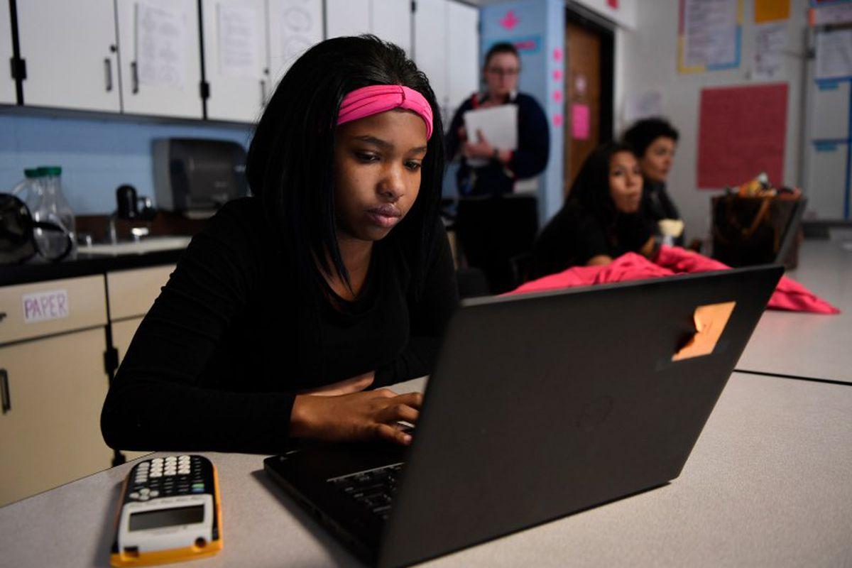 A Denver student studies for the SAT in 2017.