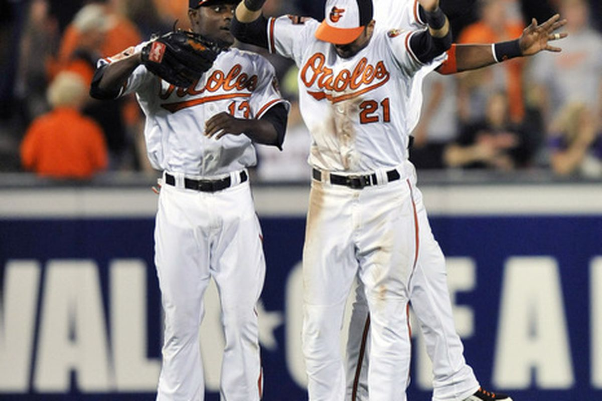 May 22, 2012; Baltimore, MD, USA; Baltimore Orioles outfielders Xavier Avery (13), and Adam Jones (10) and Nick Markakis (21) celebrate after a game against the Boston Red Sox at Oriole Park at Camden Yards. The Orioles defeated the Red Sox 4 - 1.