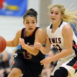 American Fork's Taylor Moeaki (13) drives past the defense of Alta's Mariah Martin (22) during the state semi-finals at Salt Lake Community College on Friday, Feb. 28, 2014.