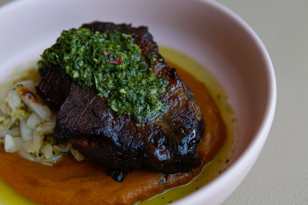 Braised beef cheeks with curried carrots and kombu-fermented cabbage at Hunky Dory