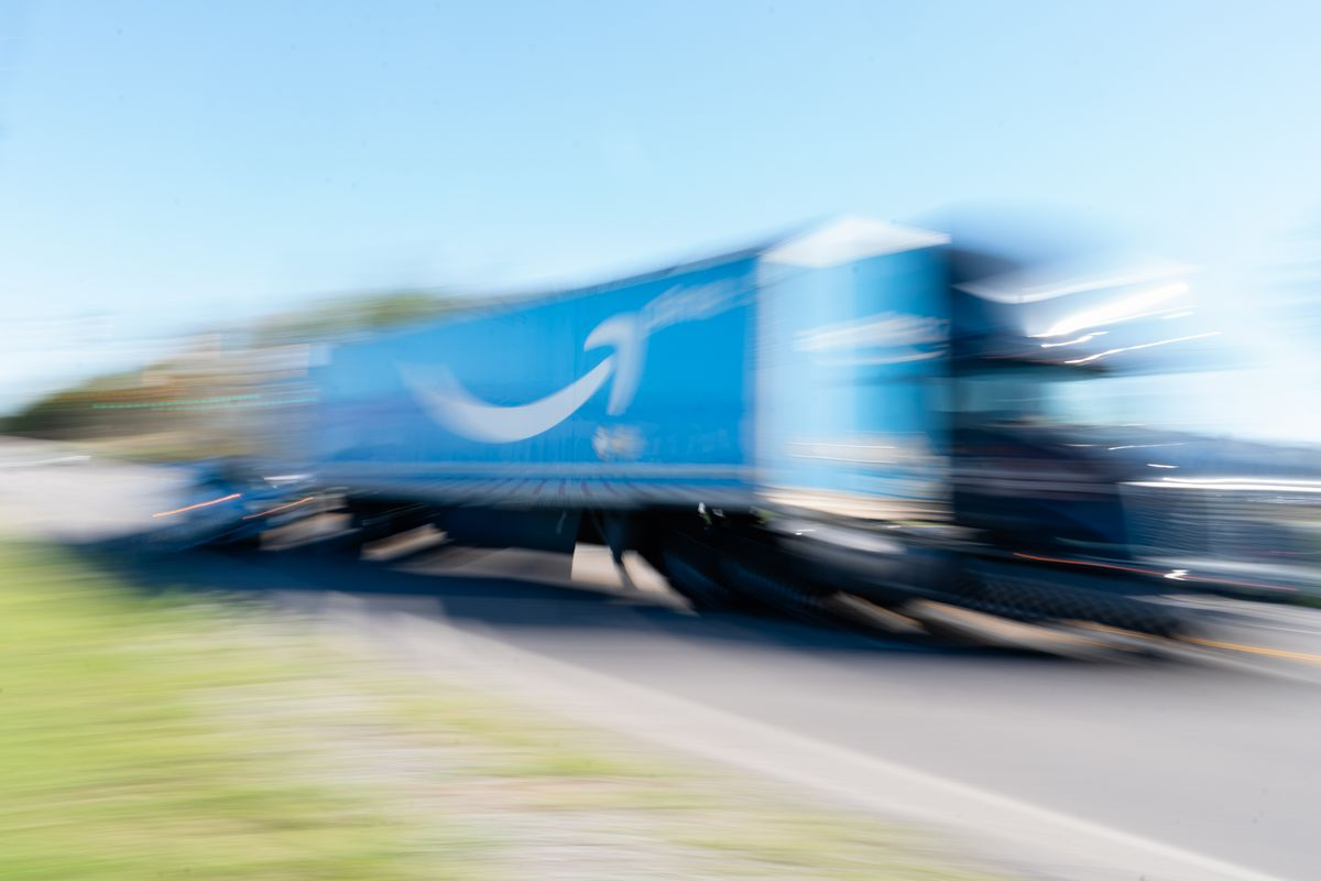 An Amazon truck seen out of focus.