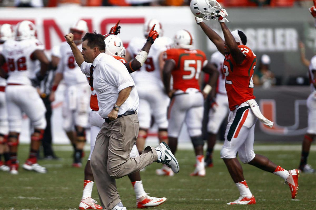 Miami coach Al Golden runs onto the football after winning an NCAA college football game against North Carolina State in Miami, Saturday, Sept. 29, 2012. Miami won 44-37.