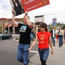 Chrissie Hynde, right, of the group Pretenders walks with PETA Vice President Dan Mathews as they join other PETA supporters at a Salt Lake City McDonald's Monday to protest the company's perceived treatment of chickens.