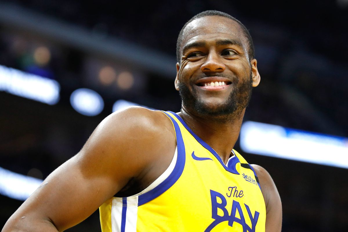 Golden State Warriors guard Alec Burks smiles on the court before the start of the fourth quarter against the Orlando Magic at Chase Center.