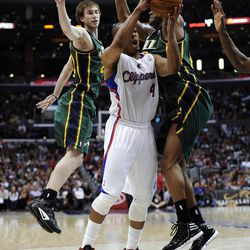 LOS ANGELES, CA - MARCH 31:  Randy Foye #4 of the Los Angeles Clippers is fouled as he attempts a shot in front of Alec Burks #10 and Gordon Hayward #20 of the Utah Jazz at Staples Center on March 31, 2012 in Los Angeles, California.  NOTE TO USER: User expressly acknowledges and agrees that, by downloading and or using this photograph, User is consenting to the terms and conditions of the Getty Images License Agreement.  (Photo by Harry How/Getty Images)