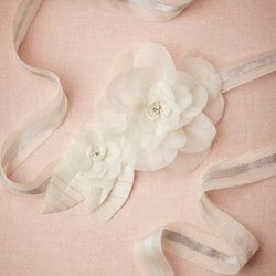 """<b>2. Rosaceae Sash, <a href=""""http://www.bhldn.com/shoes-accessories-belts-sashes/rosaceae-sash/productoptionids/fbcaeb8b-b90b-4e9a-9313-32da085940dd"""">$160</a></b>. This delicate sash made of hand-cut silk organza blooms and embellished with lucent glass"""