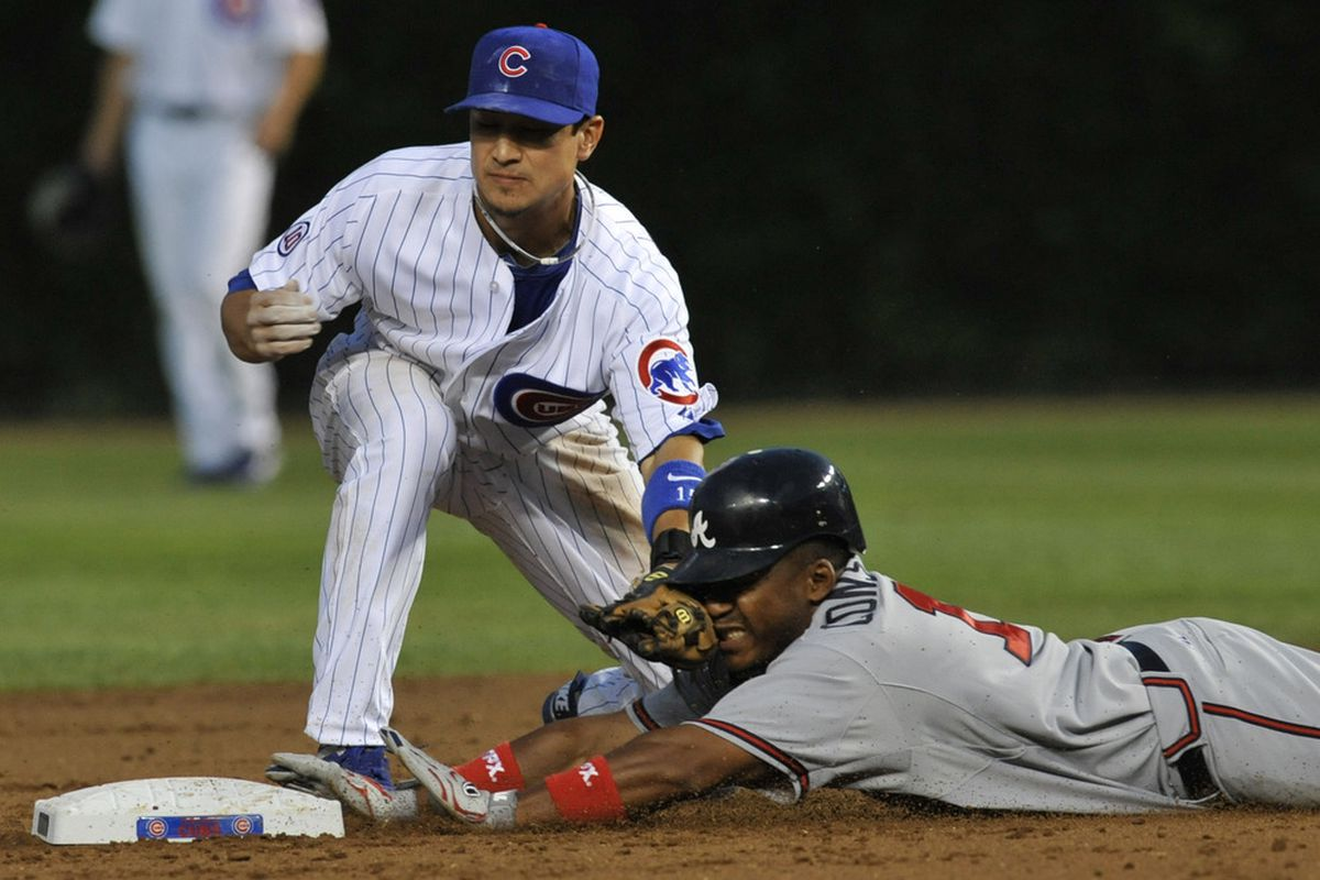 Jose Constanza of the Atlanta Braves steals second base as Darwin Barney of the Chicago Cubs makes the tag at Wrigley Field in Chicago, Illinois.  (Photo by David Banks/Getty Images)