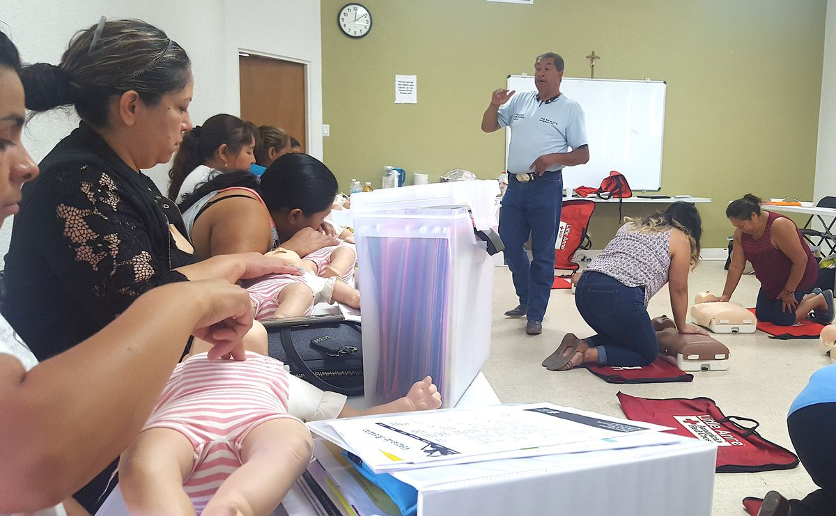Members of the PASO class practice CPR and first aid during a session in July.