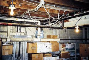 <p>The builder walked away from this potential basement remodel: The cost of dealing with obstructing utilities and water problems was too high.</p>