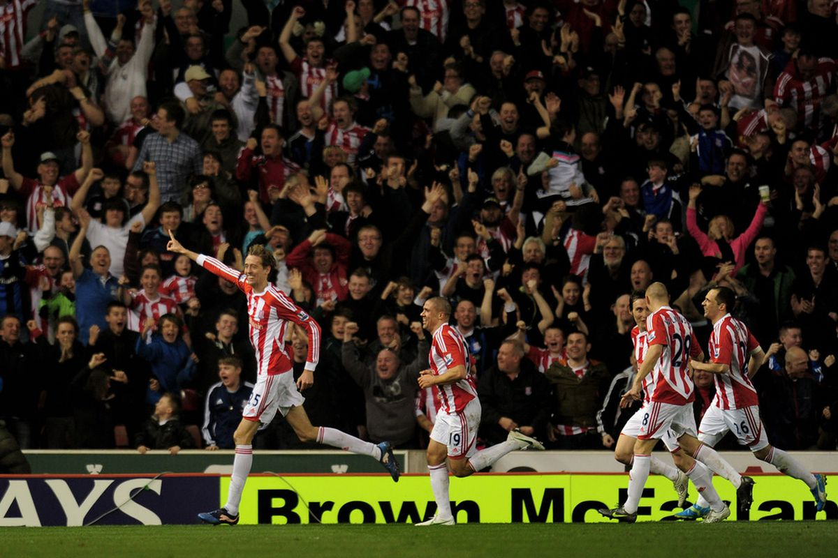 Peter Crouch celebrates a goal with his Stoke City teammates.