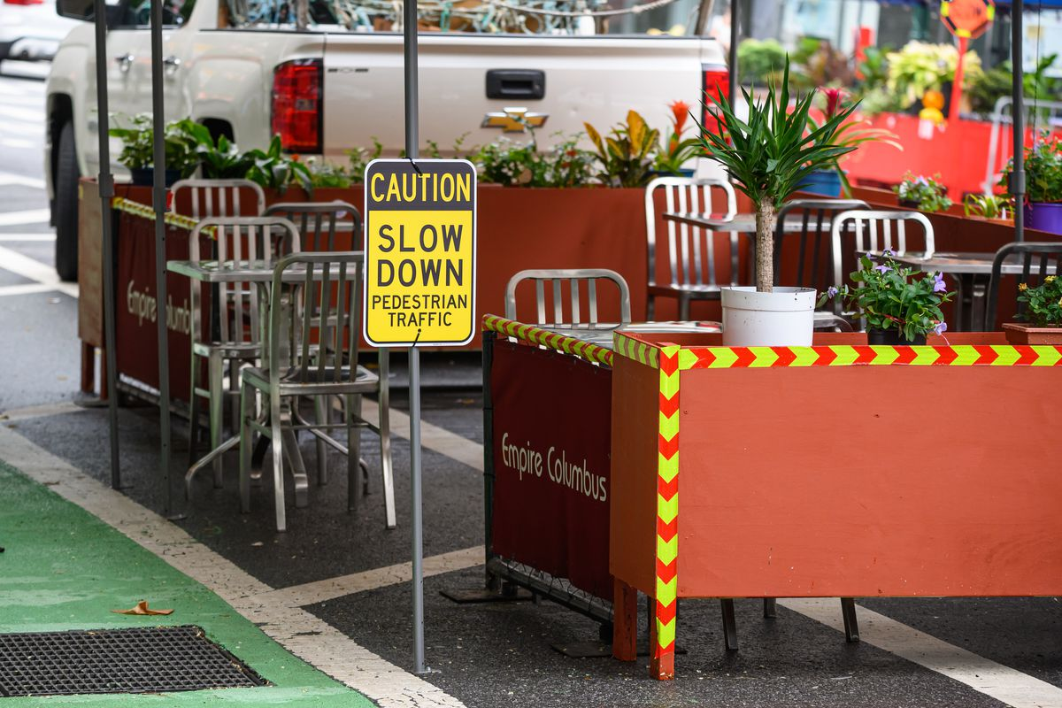 A caution sign is seen outside an outdoor dining area on the Upper West Side as the city continues Phase 4 of re-opening following restrictions imposed to slow the spread of coronavirus on August 13, 2020 in New York City.