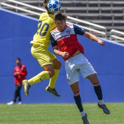 Tanner Tessmann (10) heading the ball during the opening match of the 40th Annual Dallas Cup.