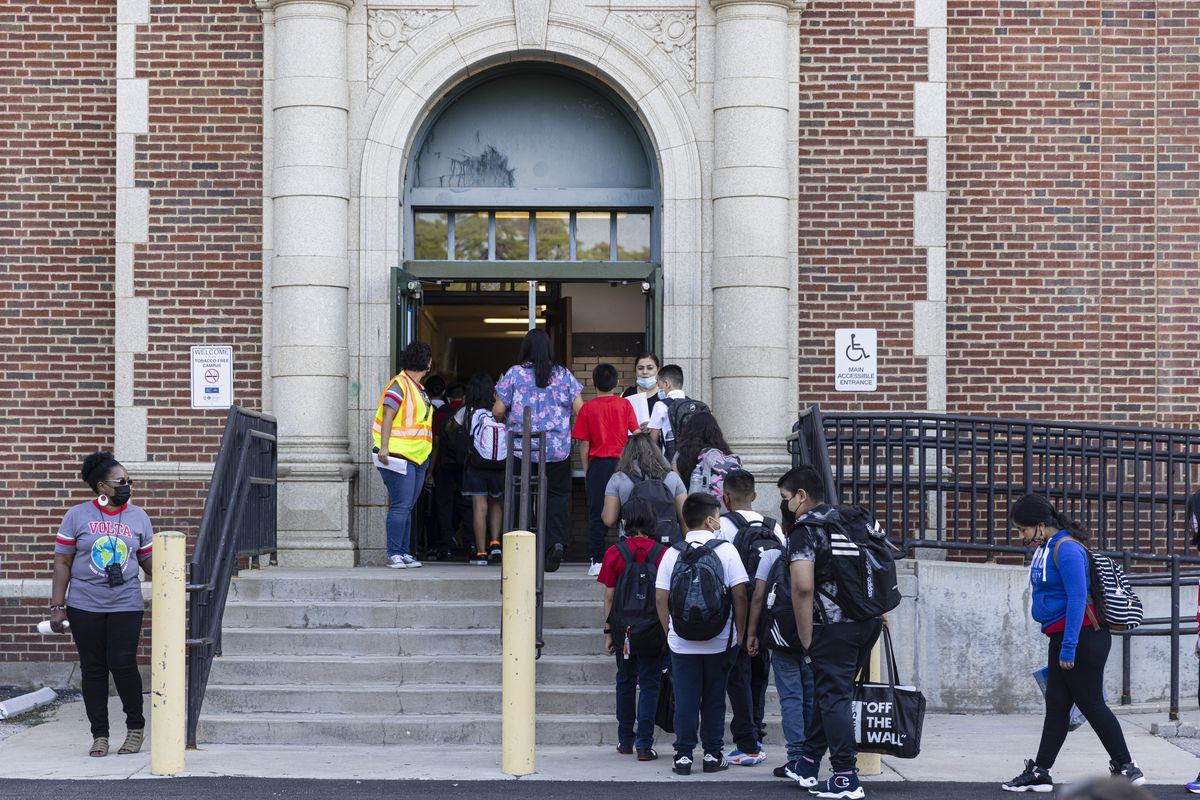 Students wait in line as they return to school on the first day of classes at Alessandro Volta Elementary School 4950 N Avers Ave. in Albany Park, Monday, Aug. 30, 2021.