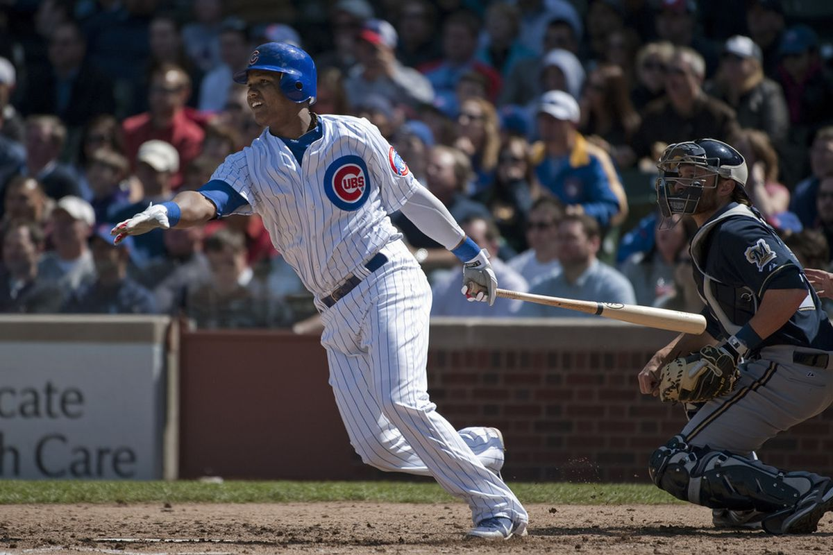Starlin Castro of the Chicago Cubs follows through on an RBI single scoring David DeJesus during the third inning against the Milwaukee Brewers at Wrigley Field in Chicago, Illinois.  (Photo by Brian Kersey/Getty Images)