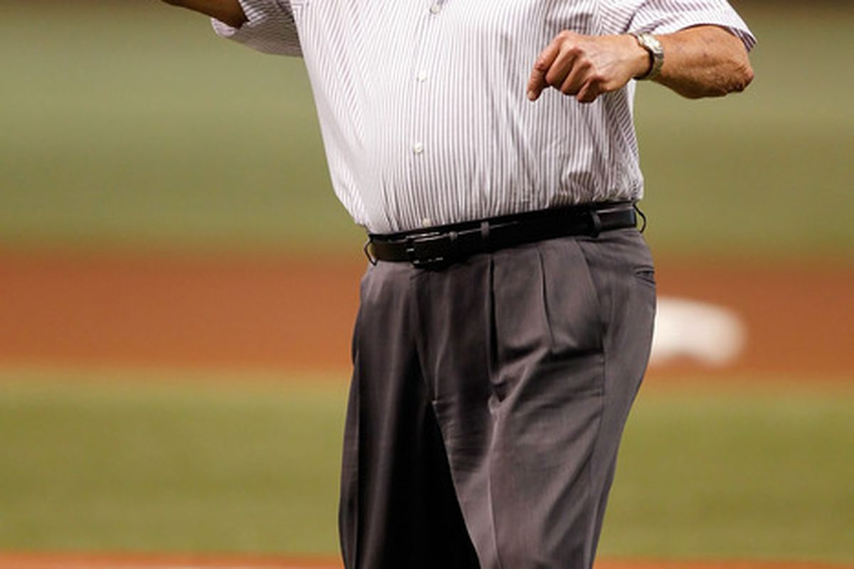 ST. PETERSBURG - AUGUST 04:  Former boxing coach Angelo Dundee throws out the first pitch of the game between the Tampa Bay Rays and the Minnesota Twins at Tropicana Field on August 4 2010 in St. Petersburg Florida.  (Photo by J. Meric/Getty Images)