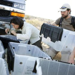 ADVANCE FOR WEEKEND, SEPT. 29 AND THEREAFTER - In this photo taken Friday, Sept. 21, 2012, Cayenne Engel, left, a research associate at UNLV, and Michael Woody, of the Desert Tortoise Conservation Center take inventory of desert tortoises that are stored in tubs prior releasing them at the Nevada National Security Site in Mercury, Nev.