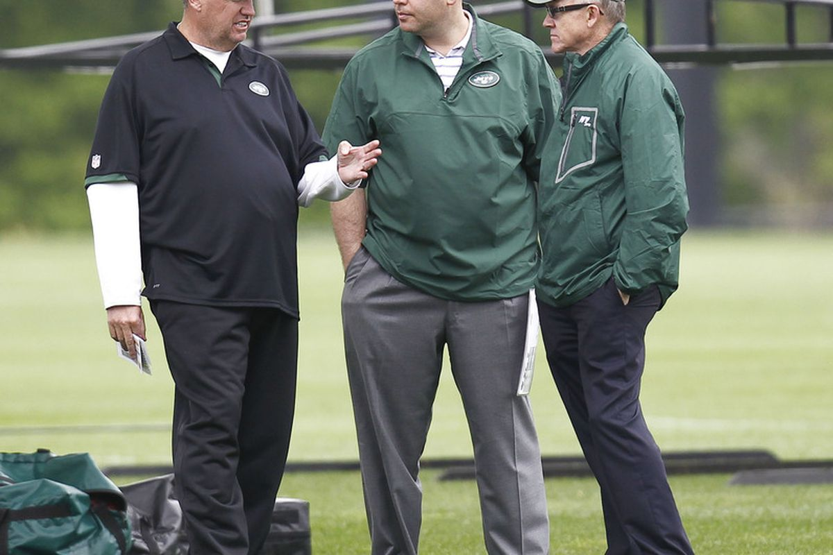 FLORHAM PARK, NJ - MAY 04:  New York Jets head coach Rex Ryan, general manager Mike Tannenbaum and team owner Woody Johnson confer during the Jets Rookie Minicamp on May 4, 2012 in Florham Park, New Jersey.  (Photo by Jeff Zelevansky/Getty Images)