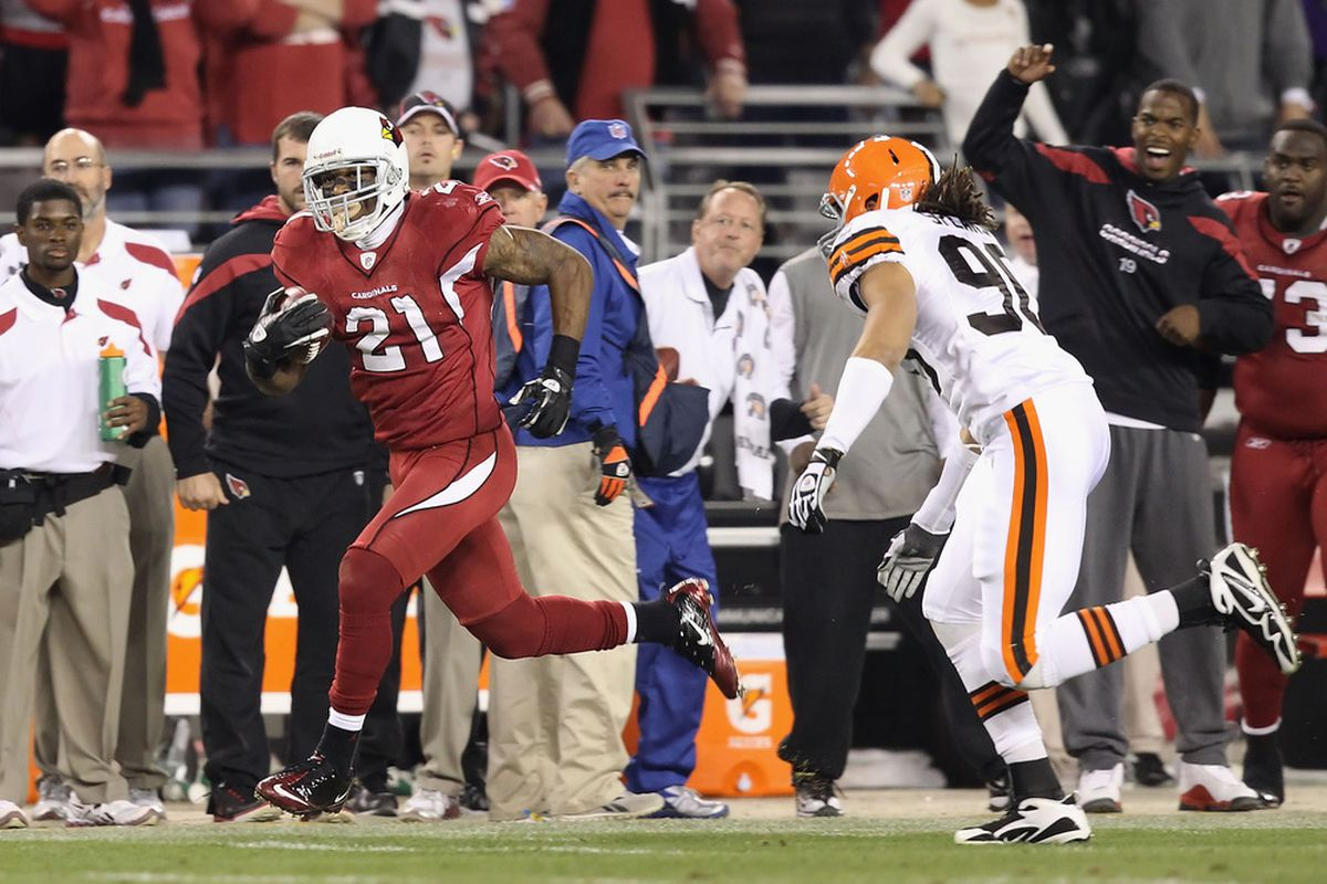 GLENDALE, AZ - DECEMBER 18:  Cornerback Patrick Peterson #21 of the Arizona Cardinals returns a punt in overtime past linebacker Quinton Spears #90 of the Cleveland Browns. (Photo by Christian Petersen/Getty Images)