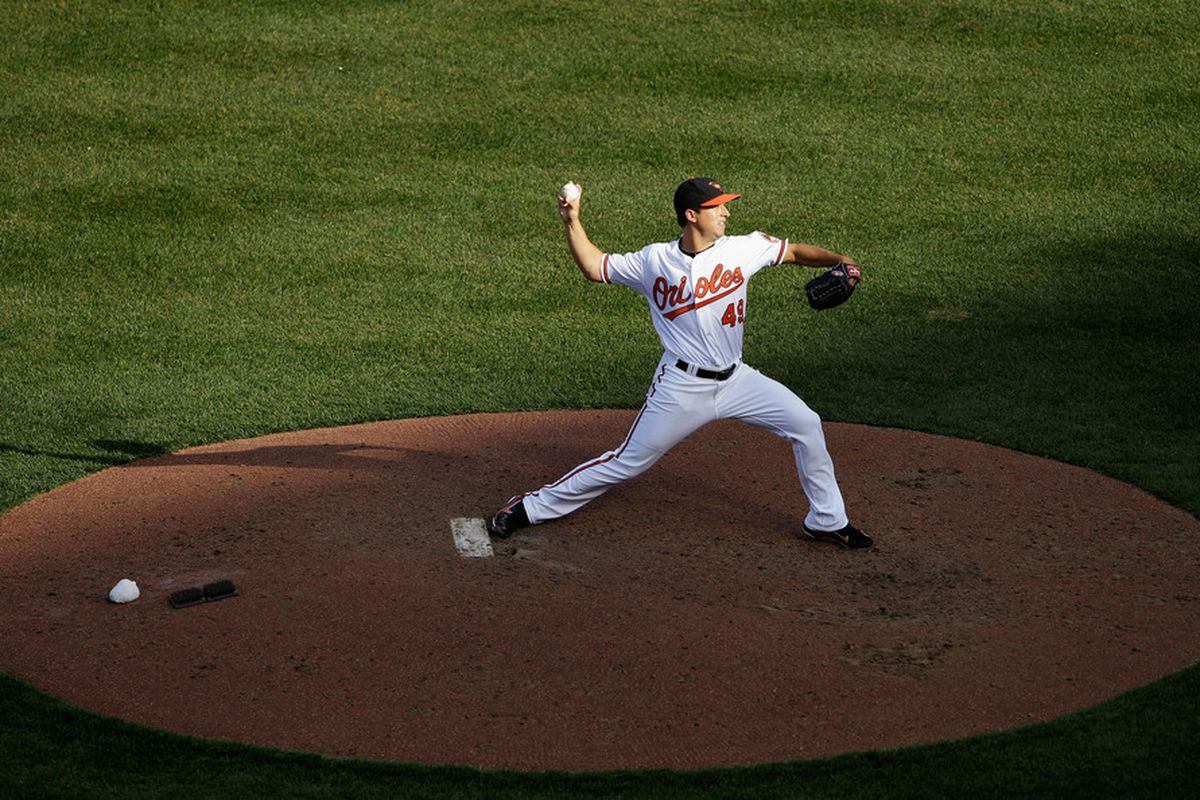 Jason Berken of the Baltimore Orioles delivers to a Detroit Tigers batter at Oriole Park at Camden Yards in Baltimore, Maryland.  (Photo by Rob Carr/Getty Images)