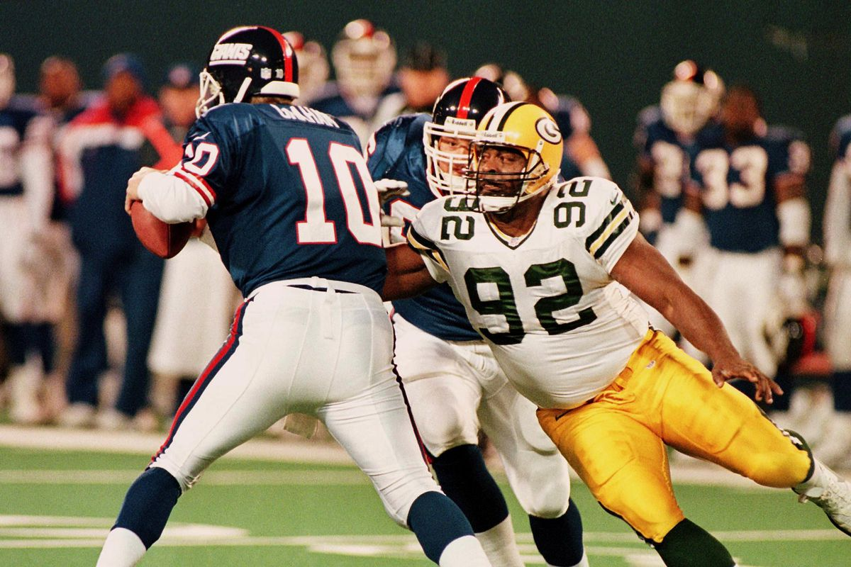 Green Bay Packers defensive end Reggie White (R) s