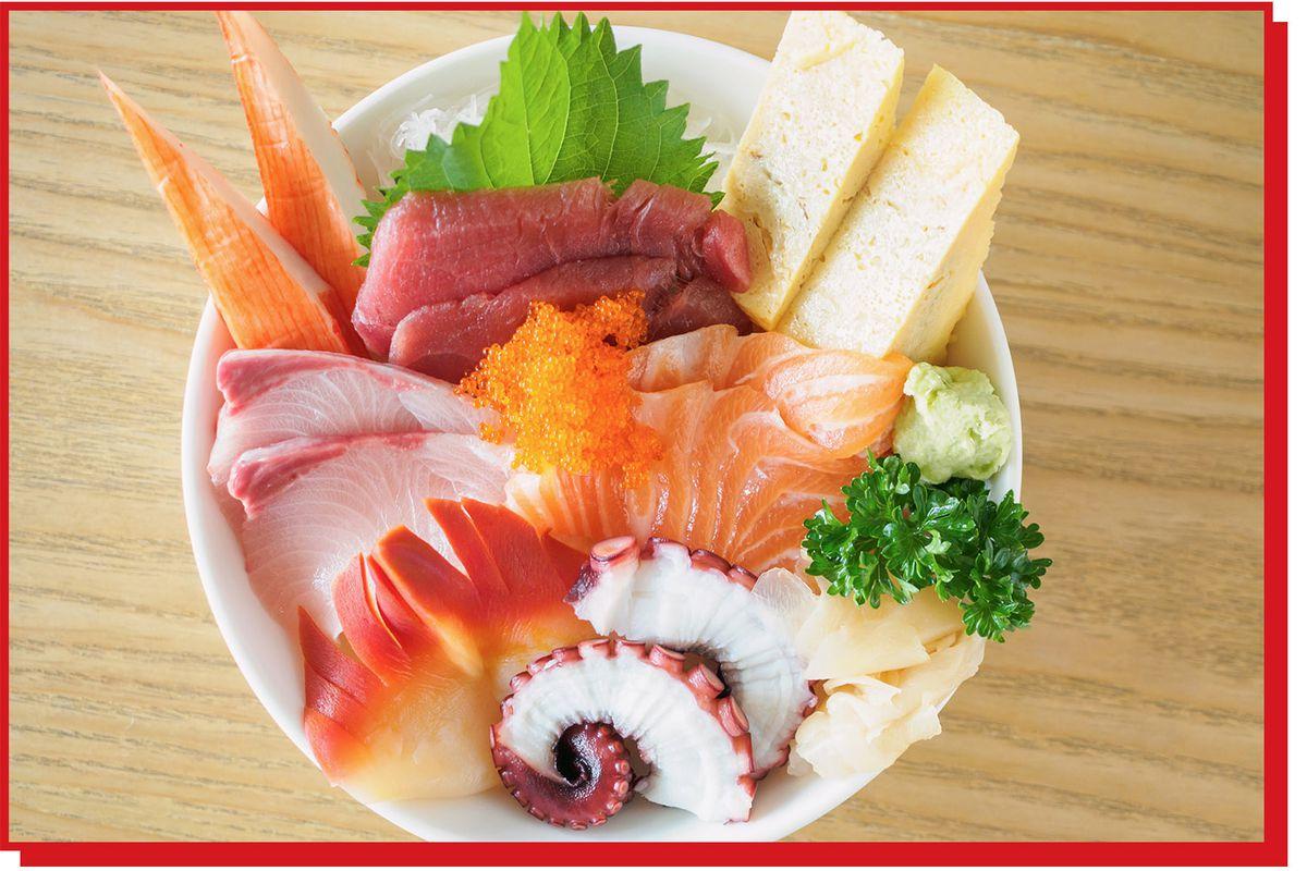 Chirashi bowl featuring salmon, tuna, octopus, tamago, whitefish.
