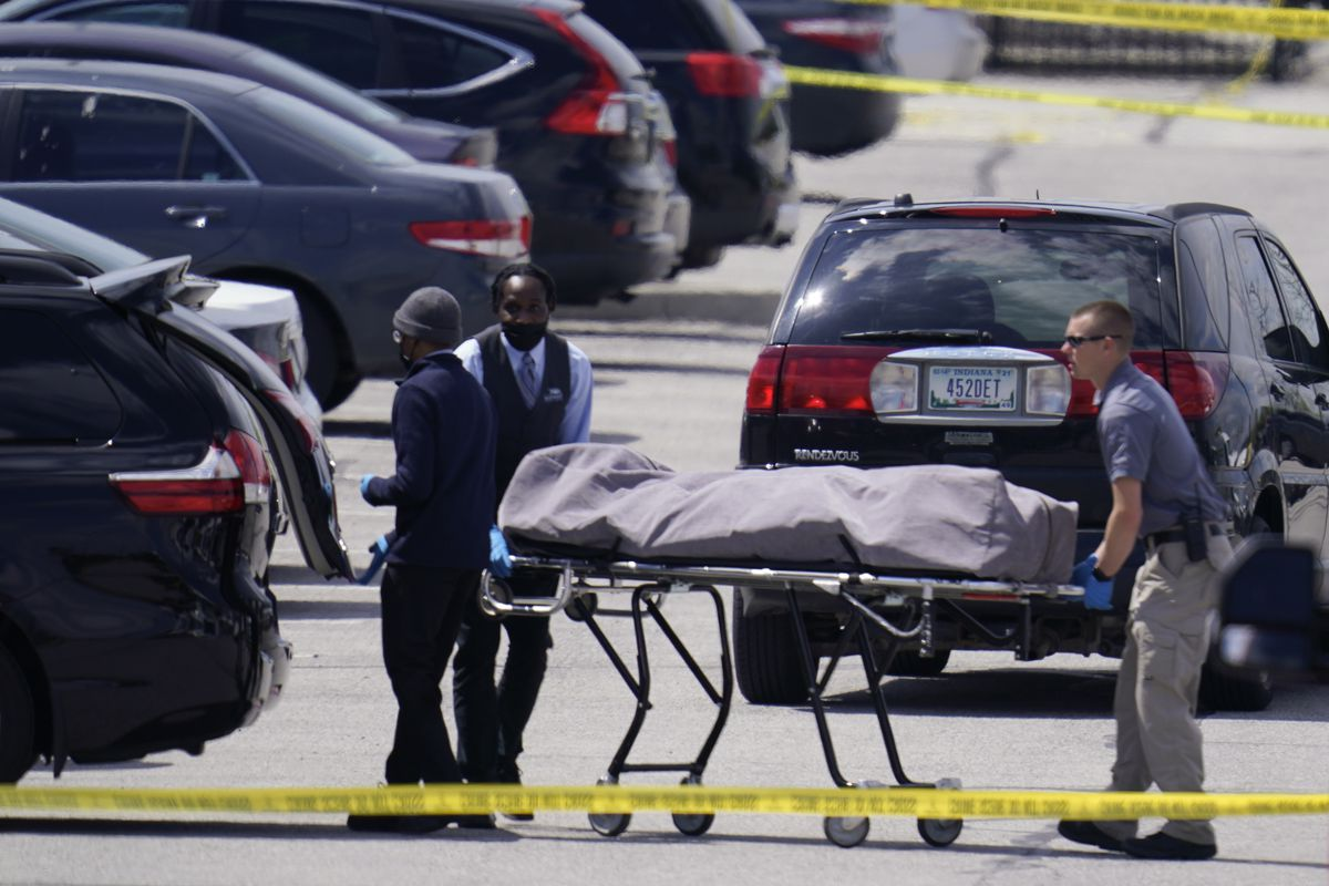 A body is taken from the scene where eight people were killed and others wounded by a gunman who then shot himself at a FedEx Ground facility in Indianapolis, Friday, April 16, 2021.