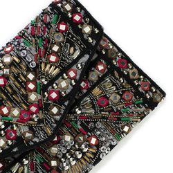 """The Euro brand's clutch packs a serious hit of color to add interest to a simple black-and-white ensemble. $69 at <a href=""""http://www.zara.com/webapp/wcs/stores/servlet/product/us/en/zara-nam-S2013/375003/1158502/EMBROIDERED+JACQUARD+CLUTCH+BAG"""">Zara</a>"""