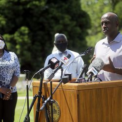 Aden Batar, Catholic Community Services migration and refugee services director, speaks during a press conference to announce the Salt Lake City Commission on Racial Equity in Policing at the International Peace Gardens in Salt Lake City on Thursday, June 25, 2020. Batar will serve on the commission.