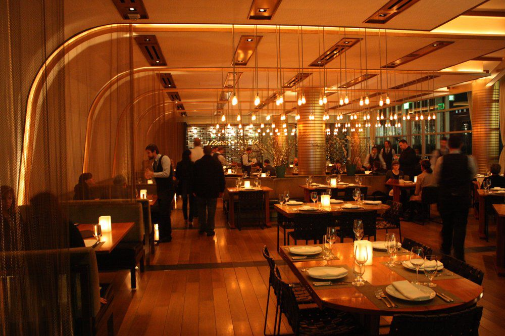 Craft restaurant with hanging lights and dim interior in Century City.