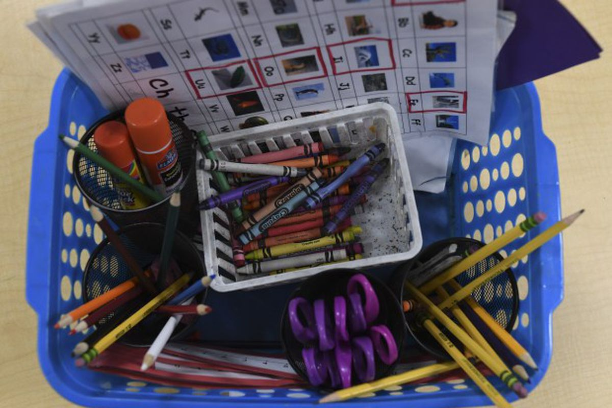 A basket of classroom supplies in a kindergarten class.