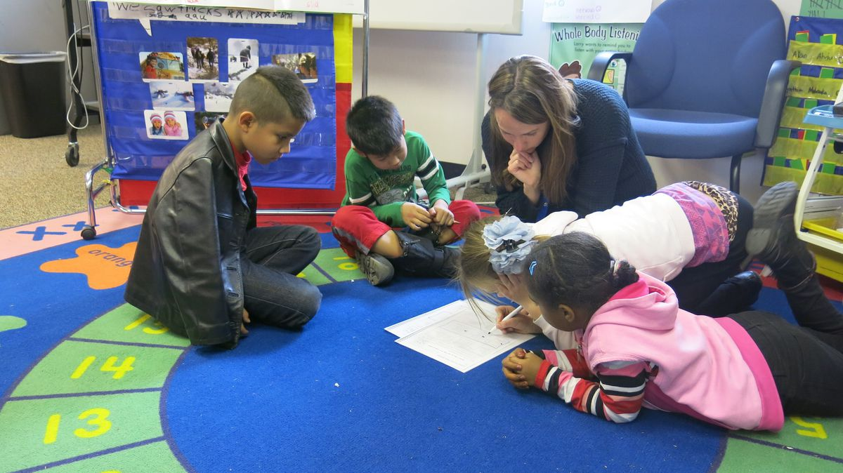 Third graders at Ellis Elementary study English with ESL teacher Bree Roon. Each of the students in this group has a different native language, including Karen, Spanish, Russian/Turkish, Arabic, and Bosnian.