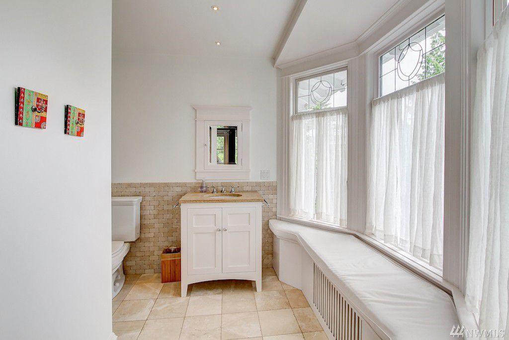 A bathroom with a window bench