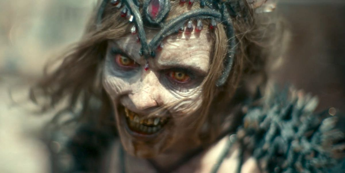 A zombie Vegas dancer growls in close-up in Army of the Dead