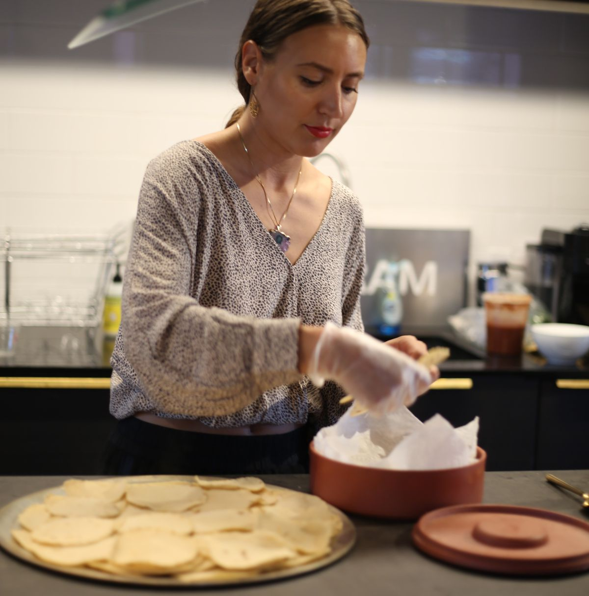 Breanne Delgado making tortillas.